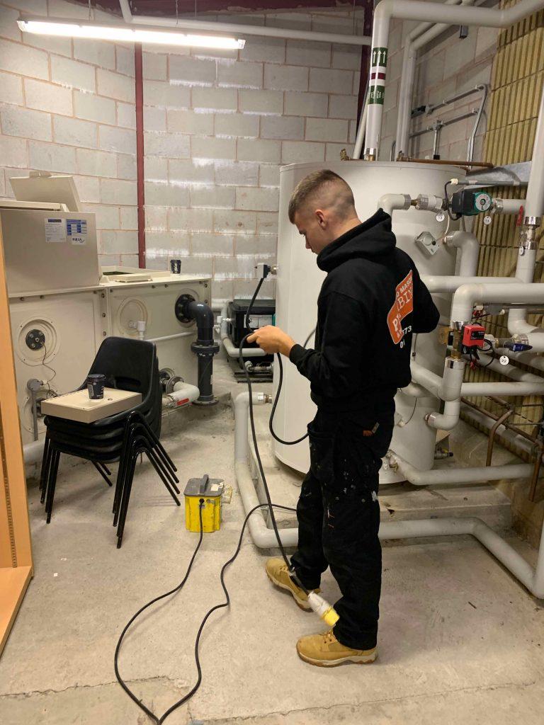 Jed Mason Plumbers working on industrial boiler in North Devon